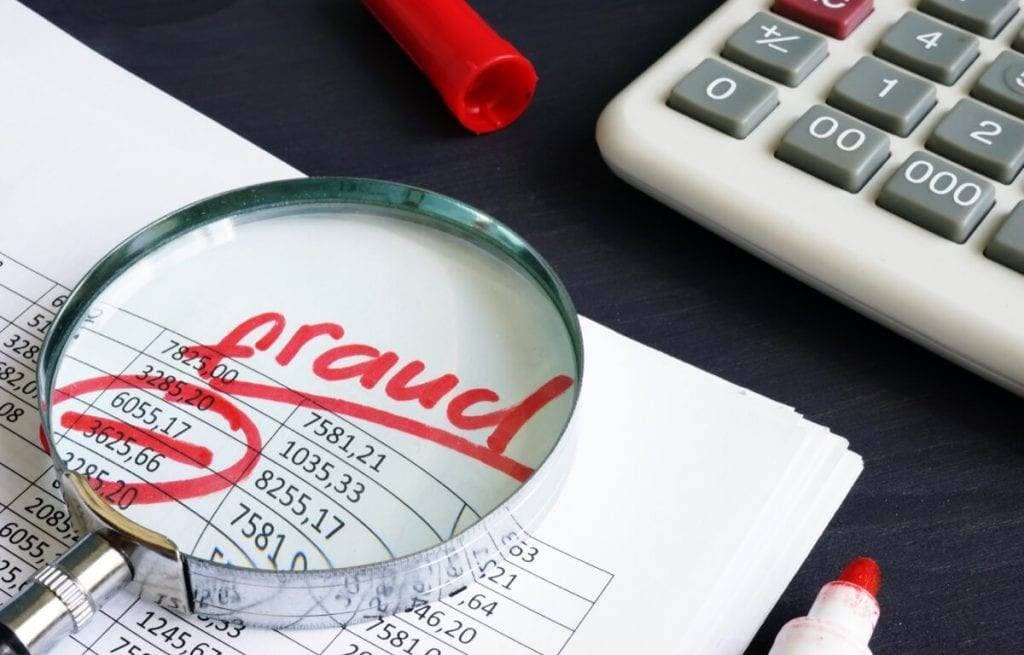 Image showing the word 'fraud' through a magnifying glass