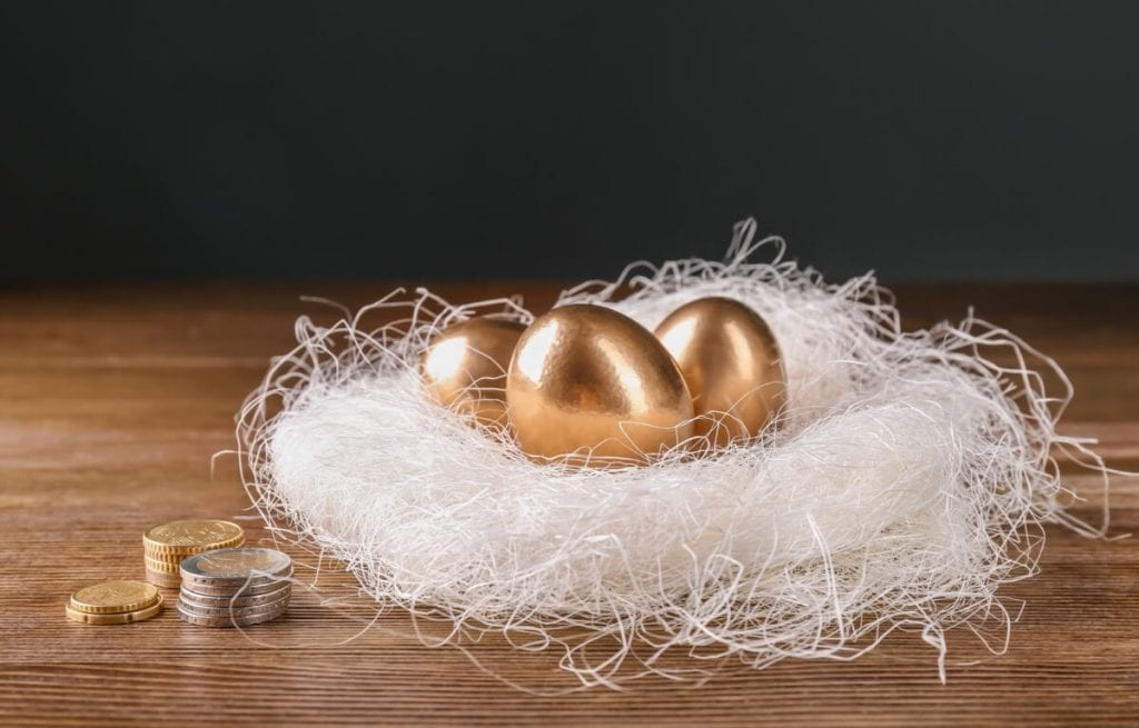 Image showing three golden eggs in a white nest.