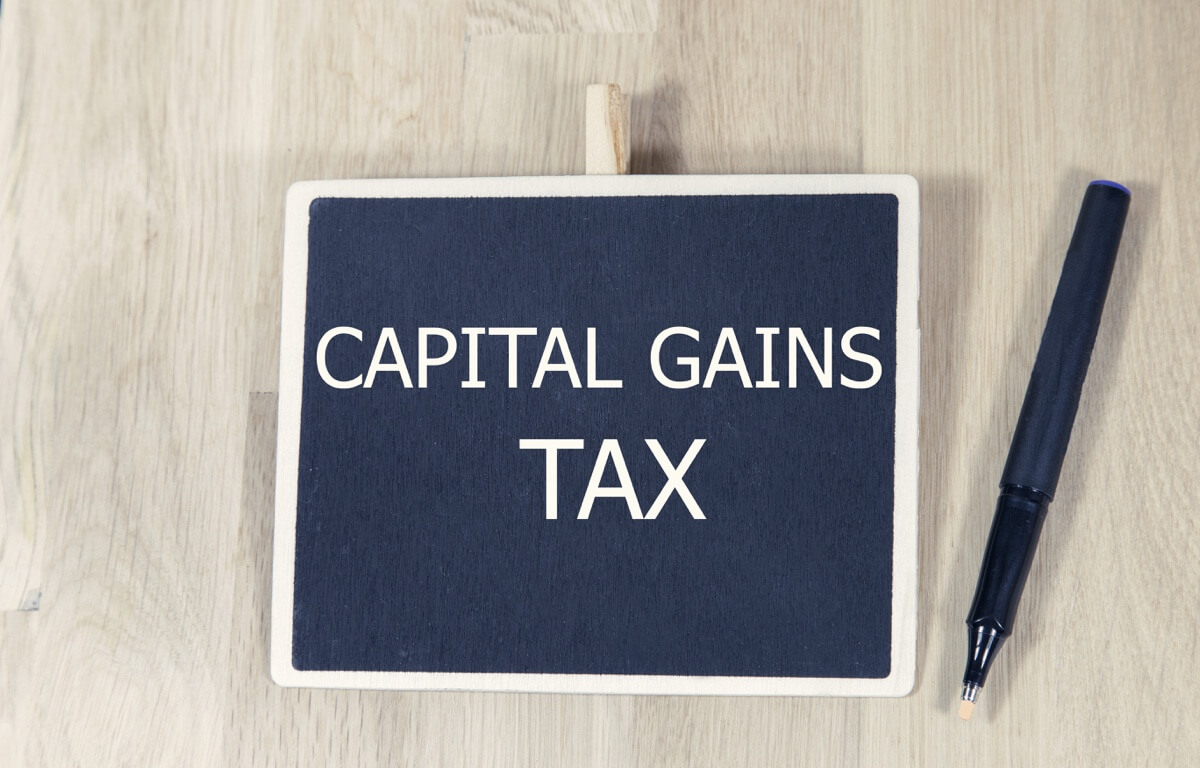 Image showing a small chalkboard with 'Capital Gains Tax' written on it.