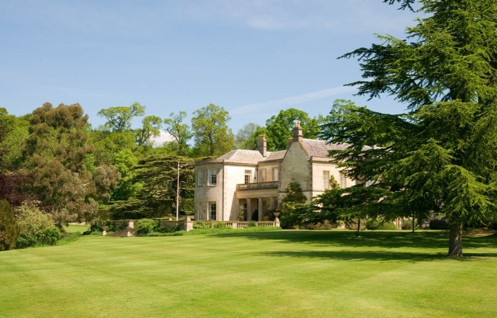 Image showing large house in pretty grounds.