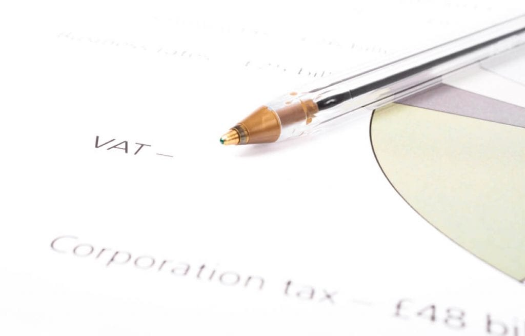 Image showing a pen pointing to the word VAT on a chart (c) Shutterstock